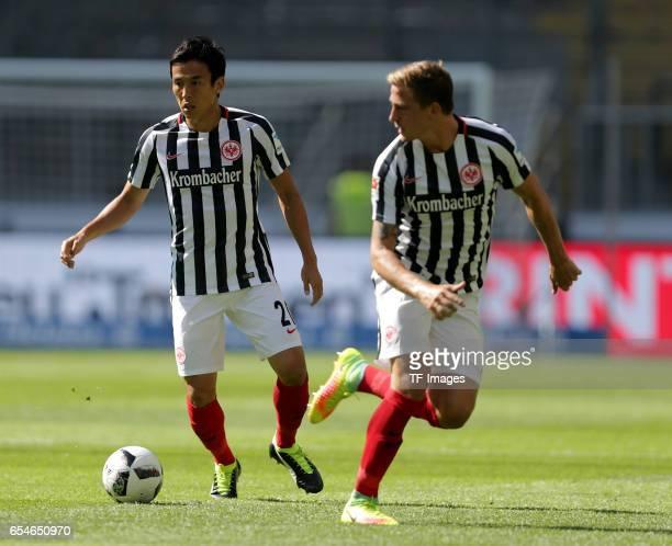 Makoto Hasebe of Frankfurt Bastian Oczipka of Frankfurt controls the ball during the Bundesliga match between Eintracht Frankfurt and FC Schalke 04...