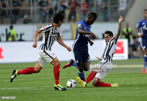 Makoto Hasebe of Frankfurt Breel Embolo of Schalke and Omar Mascarell of Frankfurt battle for the ball during the Bundesliga match between Eintracht...