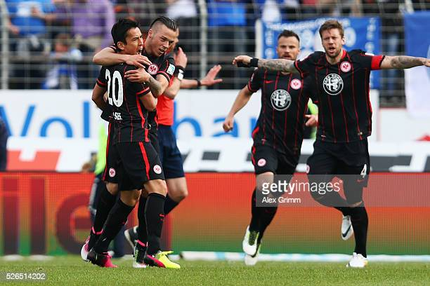 Makoto Hasebe of Frankfurt celebrates his team's first goal with team mates Yanni Regaesel Szabolcs Huszti and Marco Russ during the Bundesliga match...