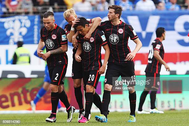Makoto Hasebe of Frankfurt celebrates his team's first goal with team mates during the Bundesliga match between SV Darmstadt 98 and Eintracht...