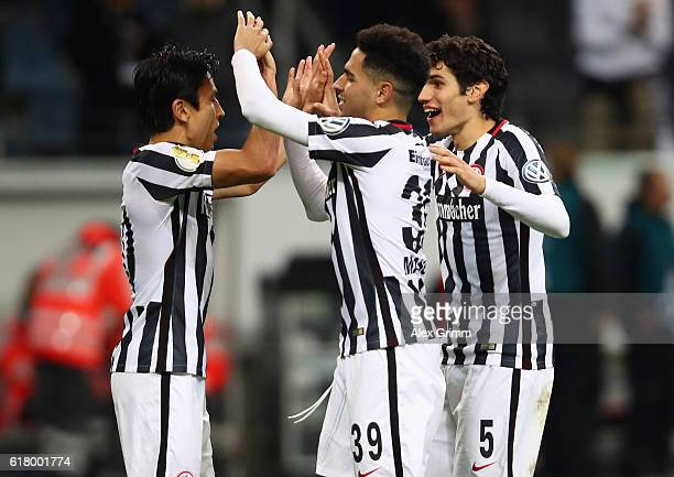 Makoto Hasebe of Frankfurt celebrates with team mates Mascarell and Jesus Vallejo after winning the penalty shootout during the DFB Cup Second Round...