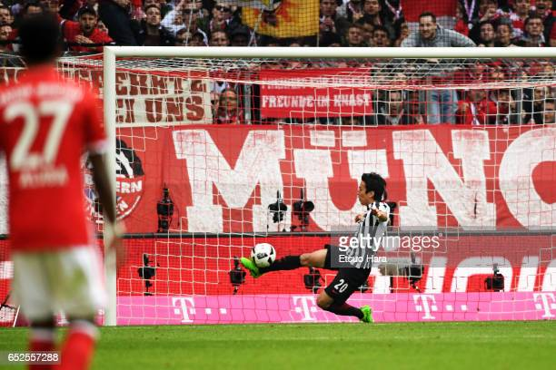 Makoto Hasebe of Frankfurt clears the ball off the line during the Bundesliga match between Bayern Muenchen and Eintracht Frankfurt at Allianz Arena...