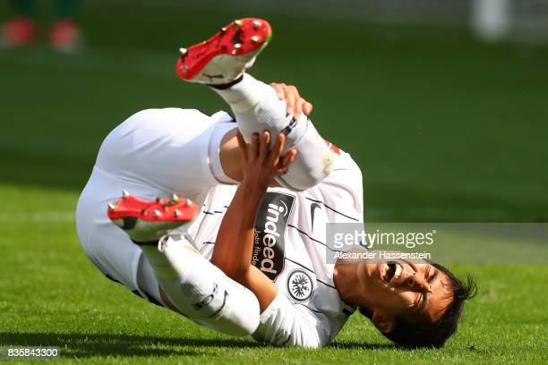 Makoto Hasebe of Frankfurt in pain on the pitch during the Bundesliga match between SportClub Freiburg and Eintracht Frankfurt at SchwarzwaldStadion...
