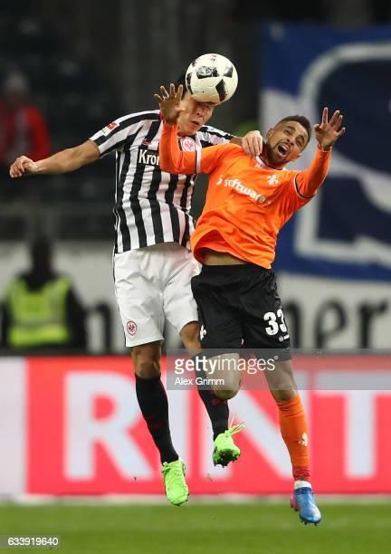 Makoto Hasebe of Frankfurt is challenged by Sidney Sam of Darmstadt during the Bundesliga match between Eintracht Frankfurt and SV Darmstadt 98 at...