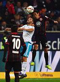 Makoto Hasebe of Frankfurt jumps for a header with Sead Kolasinac of Schalke during the Bundesliga match between Eintracht Frankfurt and FC Schalke...