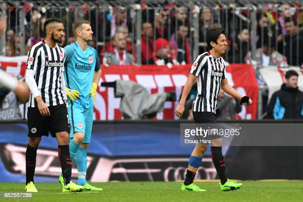 Makoto Hasebe of Frankfurt leaves the pitch after picking up injury during the Bundesliga match between Bayern Muenchen and Eintracht Frankfurt at...