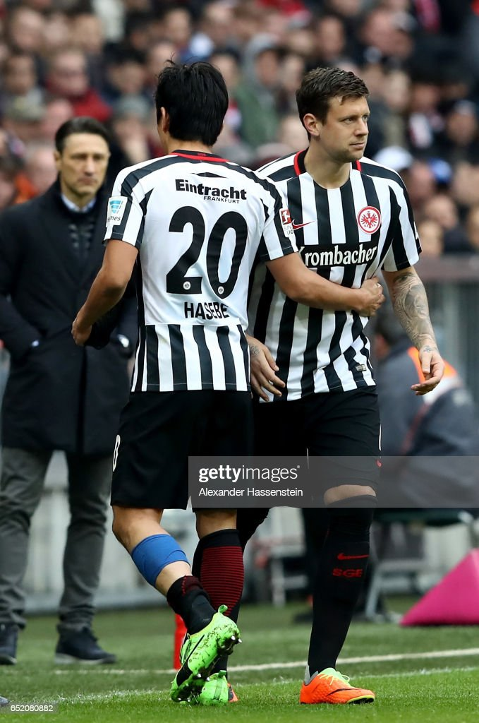 Makoto Hasebe of Frankfurt leaves the pitch for Marco Russ during the Bundesliga match between Bayern Muenchen and Eintracht Frankfurt at Allianz Arena on March 11, 2017 in Munich, Germany.