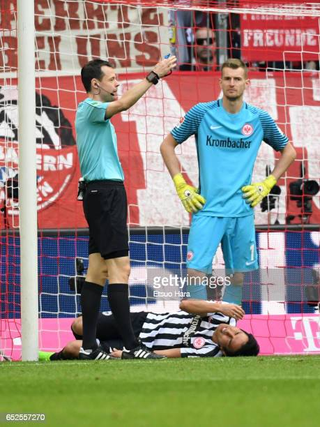 Makoto Hasebe of Frankfurt lies injured during the Bundesliga match between Bayern Muenchen and Eintracht Frankfurt at Allianz Arena on March 11 2017...
