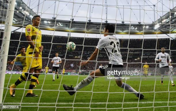 Makoto Hasebe of Frankfurt saves the ball on the line during the Bundesliga match between Eintracht Frankfurt and Borussia Dortmund at...