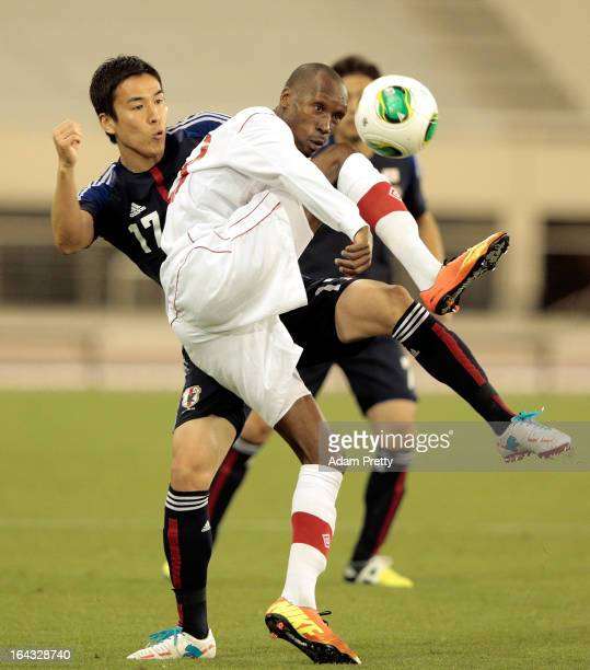 Makoto Hasebe of Japan challenges Atiba Hutchinson of Canada in action during the international friendly match between Japan and Canada at Khalifa...