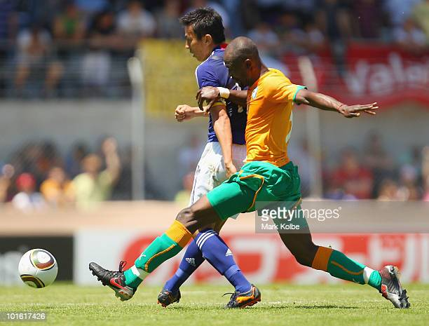 Makoto Hasebe of Japan gets a pass away under pressureduring the Japan v Ivory Coast International Friendly match at Stade de Toubillon on June 4...