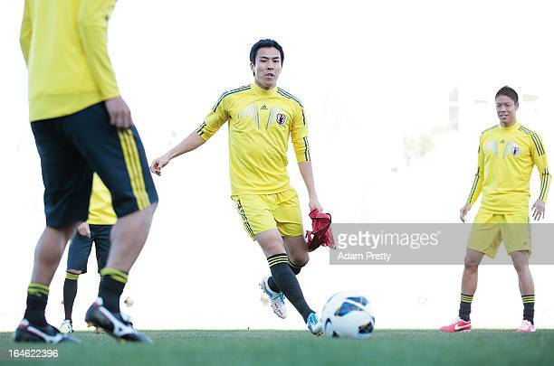 Makoto Hasebe of Japan in action during the training session ahead of the World Cup qualifier against Jordan at King Abdullah International Stadium...