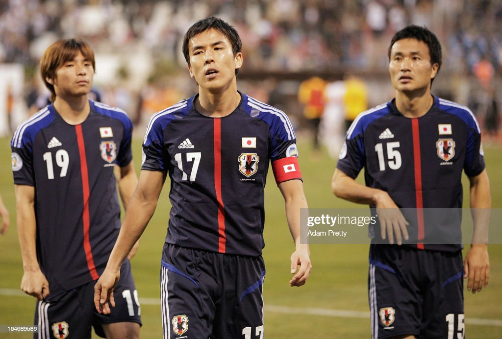 <a gi-track='captionPersonalityLinkClicked' href=/galleries/search?phrase=Makoto+Hasebe&family=editorial&specificpeople=876998 ng-click='$event.stopPropagation()'>Makoto Hasebe</a> of Japan walks off the field dejected after the FIFA World Cup Asian qualifier match between Jordan and Japan at King Abdullah International Stadium on March 26, 2013 in Amman, Jordan.