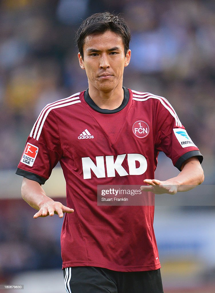 <a gi-track='captionPersonalityLinkClicked' href=/galleries/search?phrase=Makoto+Hasebe&family=editorial&specificpeople=876998 ng-click='$event.stopPropagation()'>Makoto Hasebe</a> of Nuernberg in action during the Bundesliga match between Eintracht Braunschweig and 1. FC Nuernberg at Eintracht Stadion on September 15, 2013 in Braunschweig, Germany.