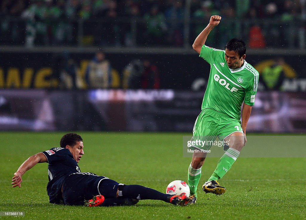 Makoto Hasebe (R) of Wolfsburg and Jeffrey Bruma (L) of Hamburg battle for the ball during the Bundesliga match between VfL Wolfsburg and Hamburger SV at Volkswagen Arena on December 2, 2012 in Wolfsburg, Germany.