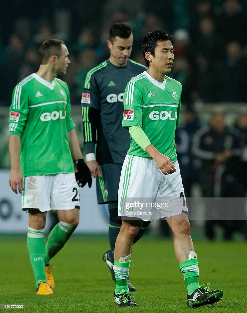 Makoto Hasebe (R-L) of Wolfsburg and teammates Diego Benaglio and Marcel Schaefer react after loosing the Bundesliga match between VFL Wolf sburg and FC Bayern Muenchen at Volkswagen Arena on February 15, 2013 in Wolfsburg, Germany.