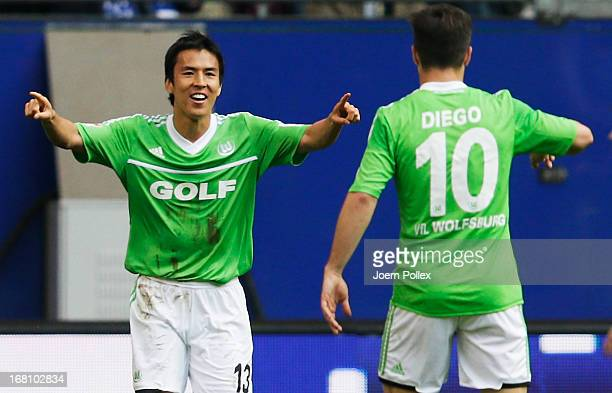 Makoto Hasebe of Wolfsburg celebrates after scoring his team's first goal during the Bundesliga match between Hamburger SV and VfL Wolfsburg at...
