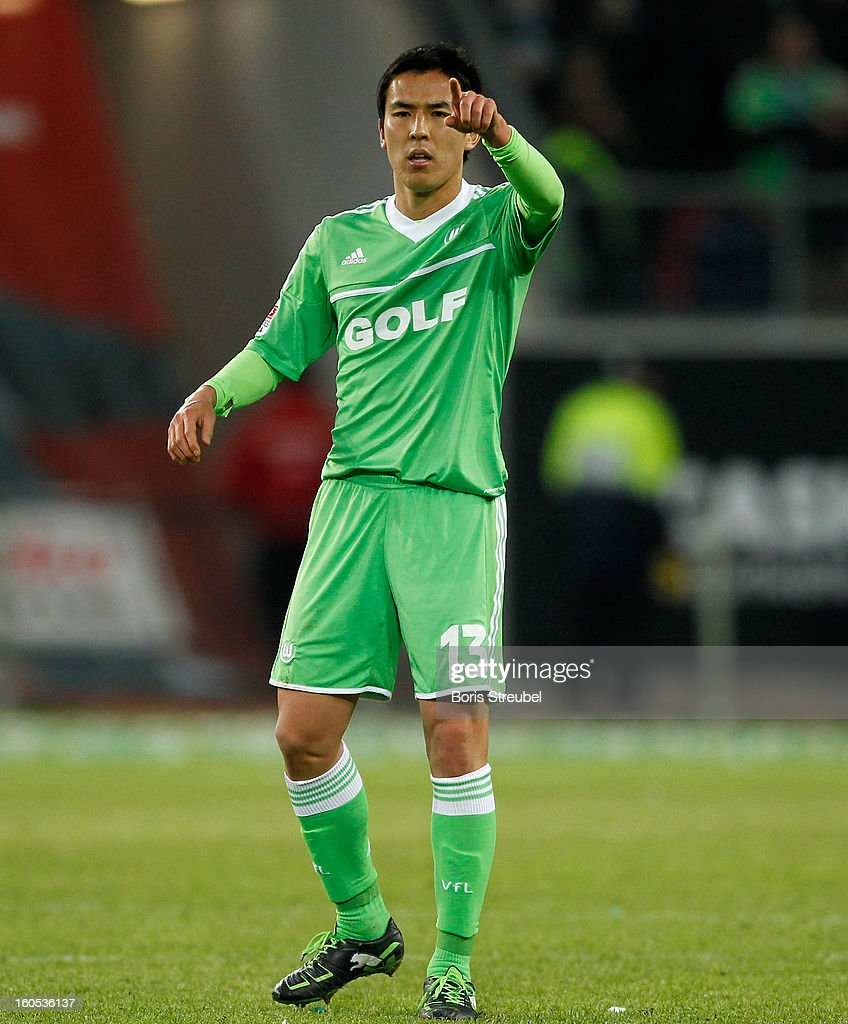 <a gi-track='captionPersonalityLinkClicked' href=/galleries/search?phrase=Makoto+Hasebe&family=editorial&specificpeople=876998 ng-click='$event.stopPropagation()'>Makoto Hasebe</a> of Wolfsburg gestures during the Bundesliga match between VFL Wolfsburg and FC Augsburg at Volkswagen Arena on February 2, 2013 in Wolfsburg, Germany.