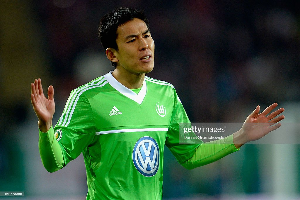 <a gi-track='captionPersonalityLinkClicked' href=/galleries/search?phrase=Makoto+Hasebe&family=editorial&specificpeople=876998 ng-click='$event.stopPropagation()'>Makoto Hasebe</a> of Wolfsburg reacts during the DFB Cup match between Kickers Offenbach and VfL Wolfsburg on February 26, 2013 in Offenbach, Germany.