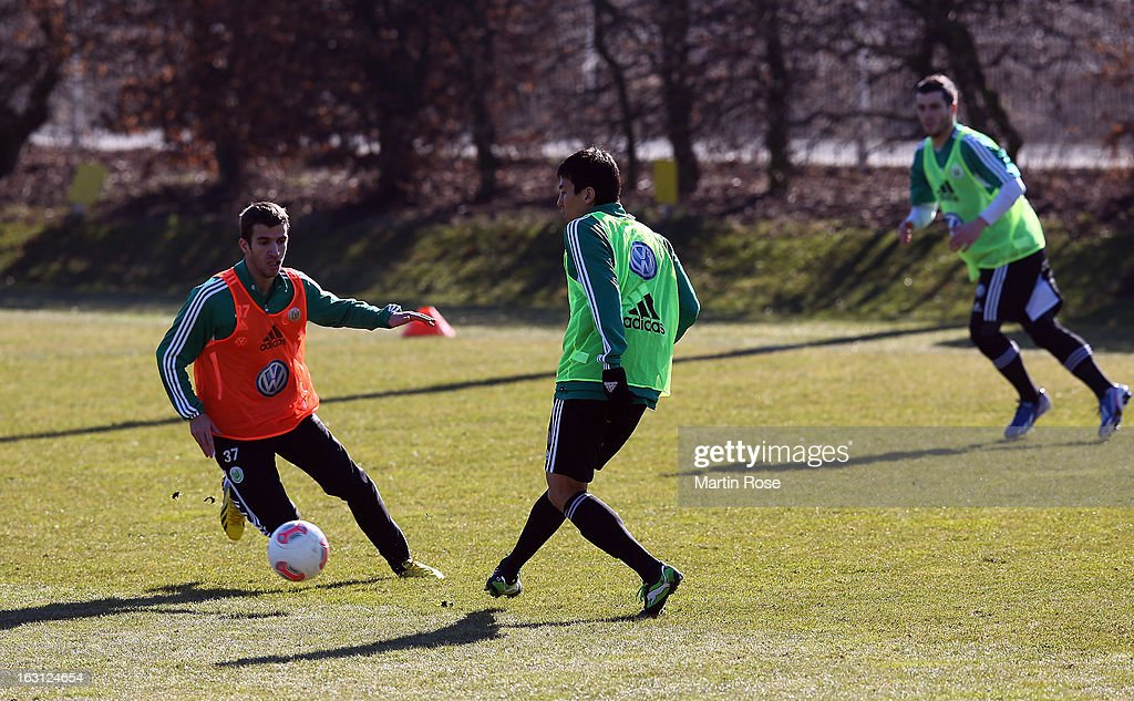 Makoto Hasebe runs with the ball during a VfL Wolfsburg training session on March 5, 2013 in Wolfsburg, Germany.