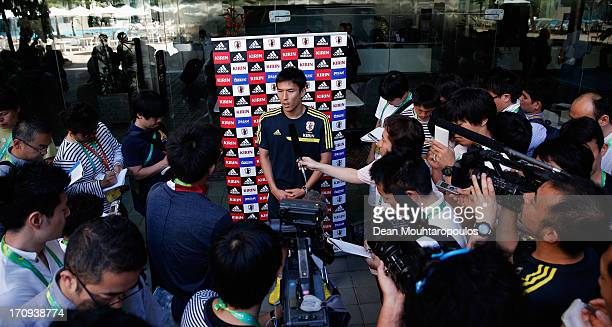 Makoto Hasebe speaks to the media during the Japan Press Conference at the Confederations Cup 2013 held at Mar Hotel on June 20 2013 in Recife Brazil