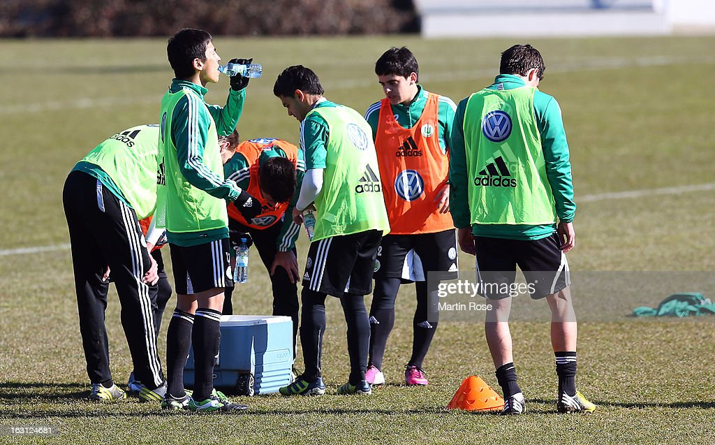 Makoto Hasebe (L) takes abreak during a VfL Wolfsburg training session on March 5, 2013 in Wolfsburg, Germany.