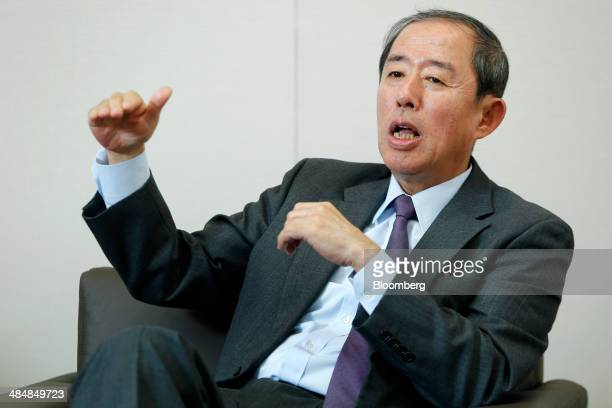 Makoto Inoue president and cochief executive officer of Orix Corp gestures as he speaks during an interview at the company's headquarters in Tokyo...