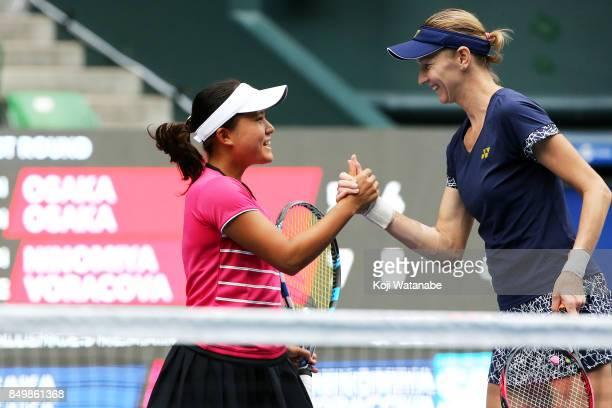 Makoto Ninomiya of Japan and Renata Voracova of Czech Republic celebrate defeating Naomi Osaka and Mari Osaka of Japan during women's doubles match...