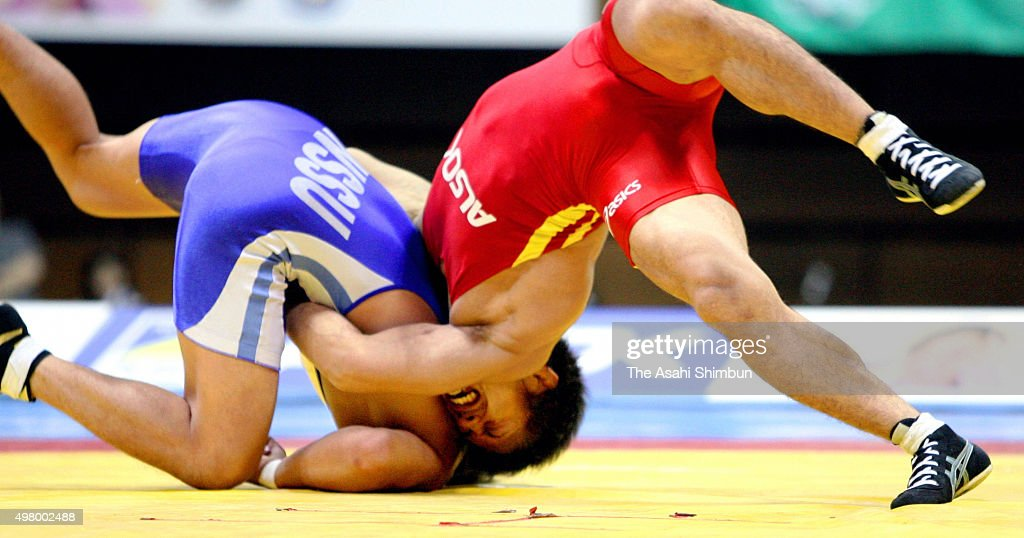 Makoto Sasamoto scores points against Ryutaro Matsumoto in the GrecoRoman 60kg final during day one of the All Japan Wrestling Championships at...