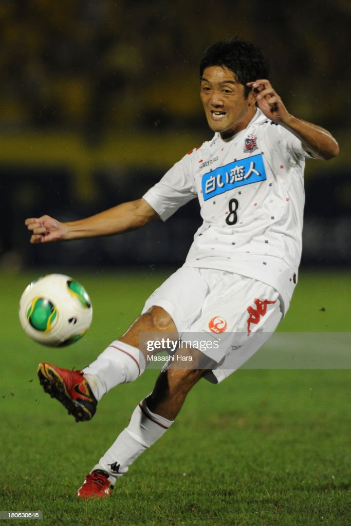 Makoto Sunakawa #8 of Consadole Sapporo in action during the J.League second division match between Tochigi SC and Consadole Sapporo at Tochigi Green Stadium on September 15, 2013 in Utsunomiya, Japan.