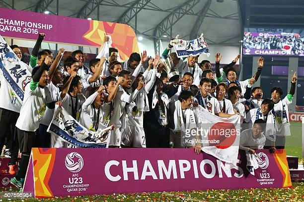 Makoto Teguramori the head coach of Japan lifts the trophy after the AFC U23 Championship final match between South Korea and Japan at the Abdullah...