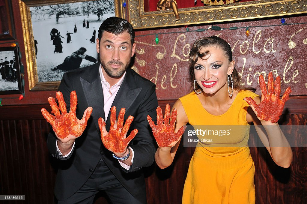 Maks Chmerkovskiy and <a gi-track='captionPersonalityLinkClicked' href=/galleries/search?phrase=Karina+Smirnoff&family=editorial&specificpeople=4029232 ng-click='$event.stopPropagation()'>Karina Smirnoff</a> celebrate their Opening Night with marinara handprints at Buca di Beppo Times Square followed by a party downstairs at Planet Hollywood Times Square on July 14, 2013 in New York City.