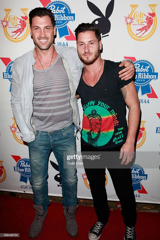 Maksim Chermovskly and Valentin Chermovskly pose at the Snoop Dogg Presents: Colt 45 Works Every Time at The Playboy Mansion Party with Evan and Daren Metropulos on October 19, 2012 in Beverly Hills, California.