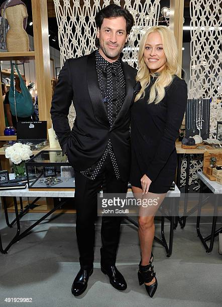 Maksim Chmerkovskiy and Peta Murgatroyd attend the launch of Cantamessa Man with Maksim Chmerkovskiy at the Closet by Sharon Segal and Nina Segal at...