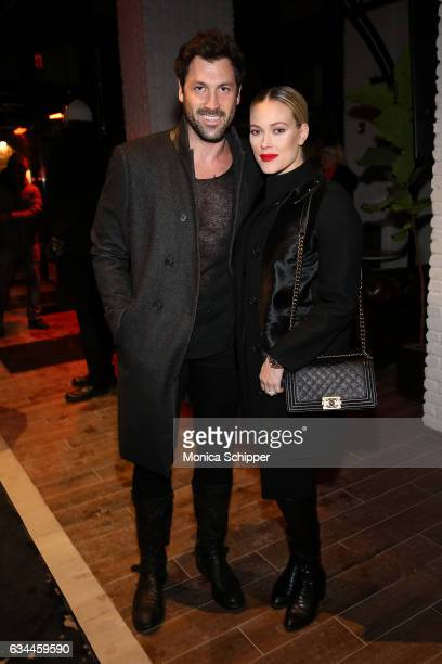 Maksim Chmerkovskiy and Peta Murgatroyd attend the VALENTINNICOLE fashion show during New York Fashion Week at Lovage on February 9 2017 in New York...