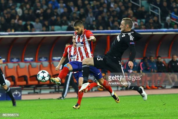 Maksim Medvedev of Qarabag Agdam in action against Yannick Carrasco of Atletico Madrid during the UEFA Champions League Group C soccer match between...