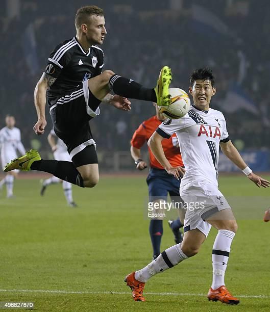Maksim Medvedev of Qarabag FK challenged by Son Heungmin of Tottenham Hotspur FC during the UEFA Europe League match between Qarabag FK and Tottenham...