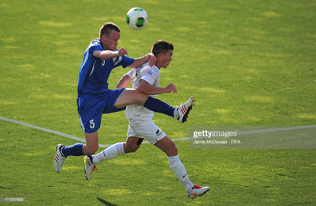 Maksimilian Fomin of Uzbekistan battles with Tim Payne of New Zealand during the FIFA U-20 World Cup Group F match between New Zealand and Uzbekistan at the Ataturk Stadium on June 23, 2013 in Bursa, Turkey.