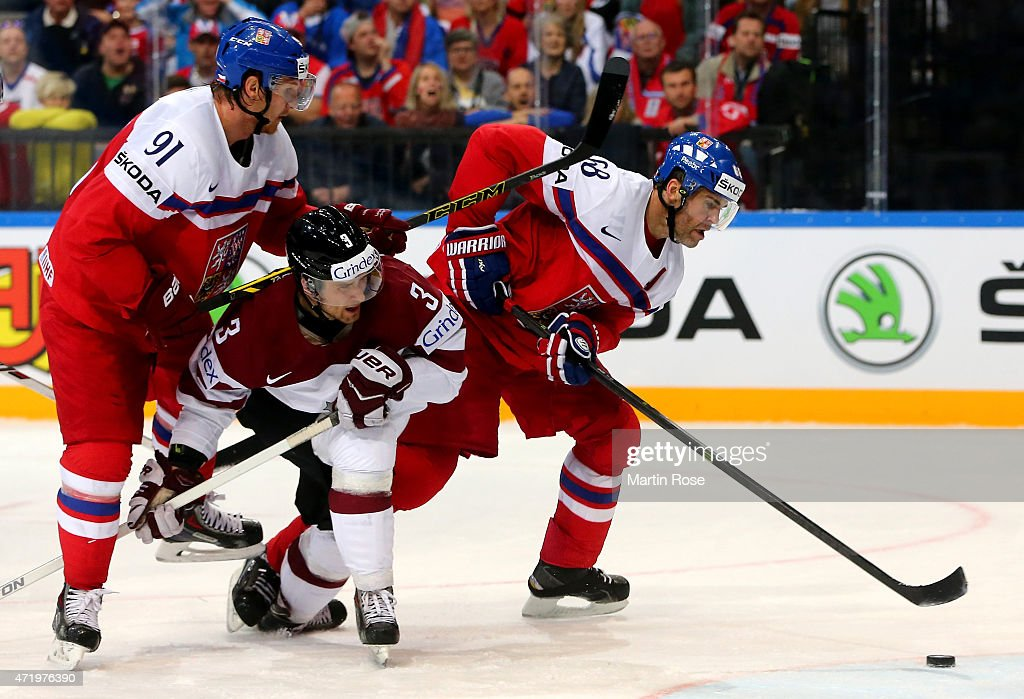 Maksims Sirokovs (L) of Latvia and Jaromir Jagr (R) of Czech Republic battle for the puck during the IIHF World Championship group A match between Latvia and Czech Republic at o2 Arenaon May 2, 2015 in Prague, Czech Republic.