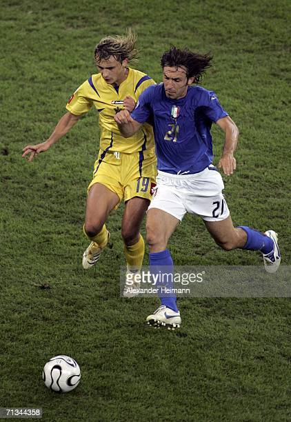 Maksym Kalinichenko of the Ukraine competes for the ball with Andrea Pirlo of Italy during the FIFA World Cup Germany 2006 Quarterfinal match between...