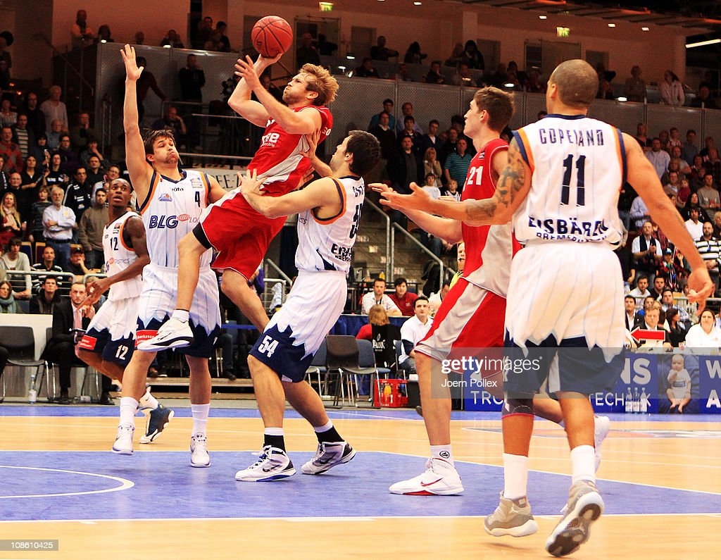 Maksym Shtein of Bremerhaven moves against John Goldsberry of Brose Baskets during the Basketball Bundesliga match between Eisbaeren Bremerhaven and...