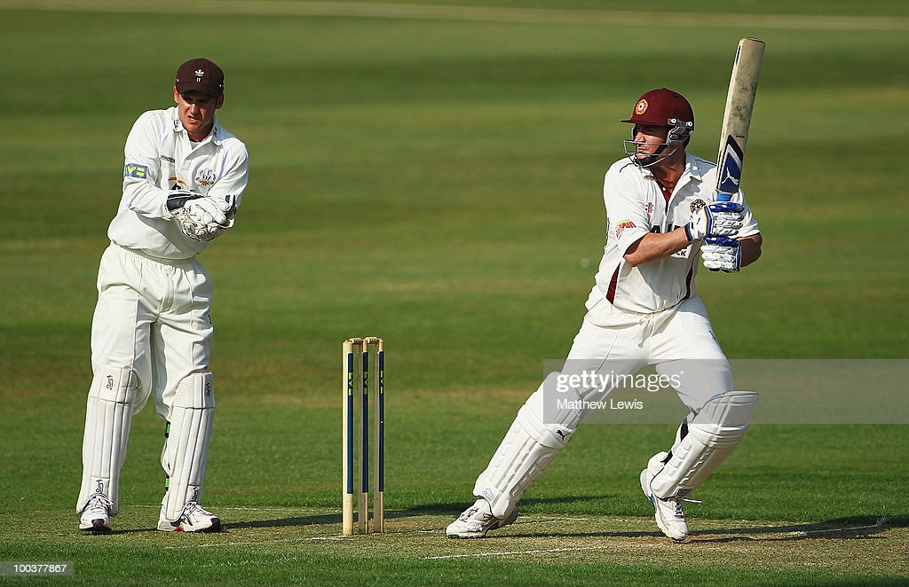 Mal Loye of Northamptonshire hits the ball towards the boundary, as Steve Davies of Surrey looks on during the LV County Championship match between Northamptonshire and Surrey at the County Ground on May 24, 2010 in Northampton, England.
