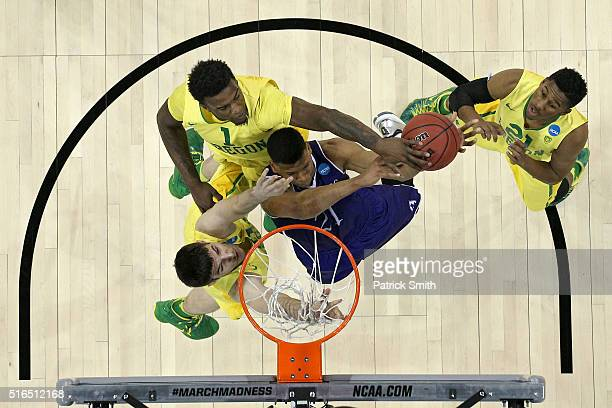 Malachi Alexander of the Holy Cross Crusaders has his shot blocked by Jordan Bell of the Oregon Ducks in the first half during the first round of the...