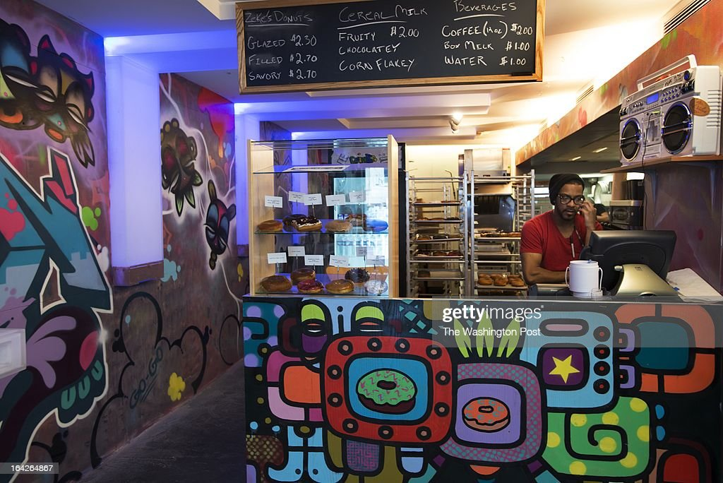 WASHINGTON, DC - Malachi Broadnax is a manager at a doughnut shop owned by Zeke Gordon. Gordon changed the name of the business after some controversy. Interior of business in Washington, DC on January 31, 2013.