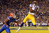 Malachi Dupre of the LSU Tigers catches a touchdown over Quincy Wilson of the Florida Gators at Tiger Stadium on October 17 2015 in Baton Rouge...