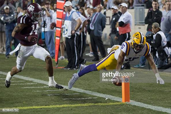 Malachi Dupre of the LSU Tigers dives for the pylon but was ruled out art the three yard line as Justin Evans of the Texas AM Aggies pursued in the...