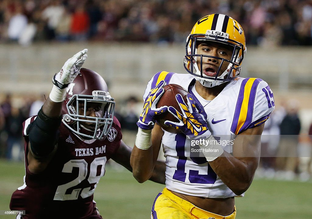 Malachi Dupre of the LSU Tigers hauls in a long pass in front of Deshazor Everett of the Texas AM Aggies in the second half of their game at Kyle...