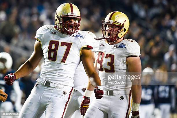 Malachi Moore and Kevin Kavalec of the Boston College Eagles celebrate a sack in the second quarter during a game against the Penn State Nittany...