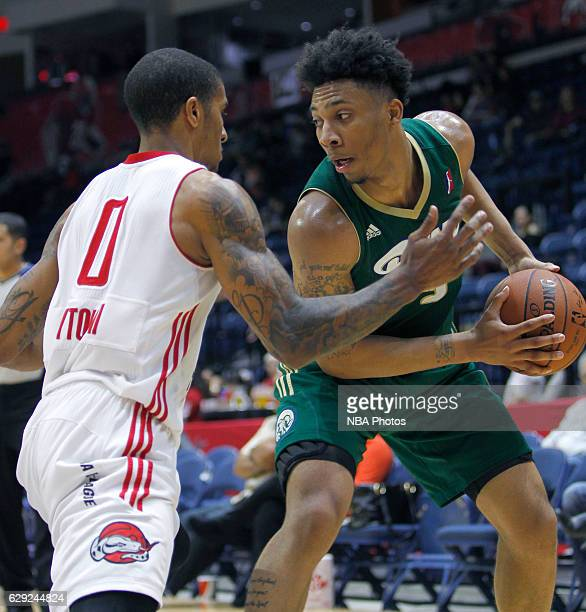 Malachi Richardson of the Reno Bighorns handles the ball against Gary Payton II of the Rio Grande Valley Vipers at the State Farm Arena December 11...