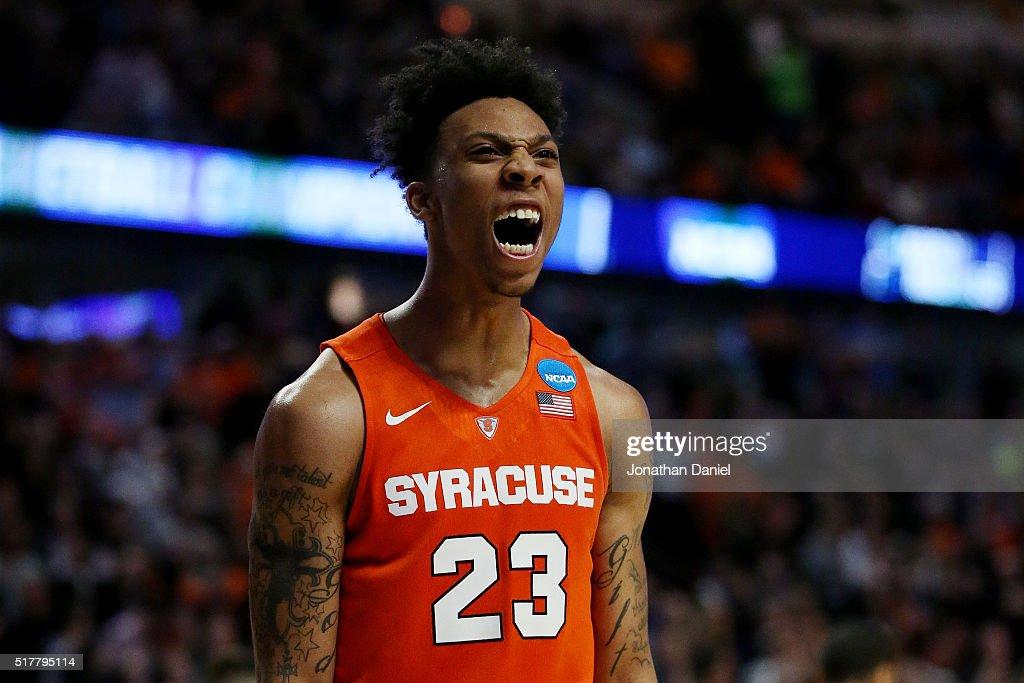 Malachi Richardson of the Syracuse Orange celebrates their 68 to 62 win over the Virginia Cavaliers with teammates during the 2016 NCAA Men's...